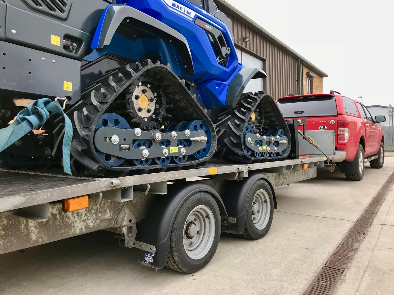 Compact Tracked Loader on trailer transport