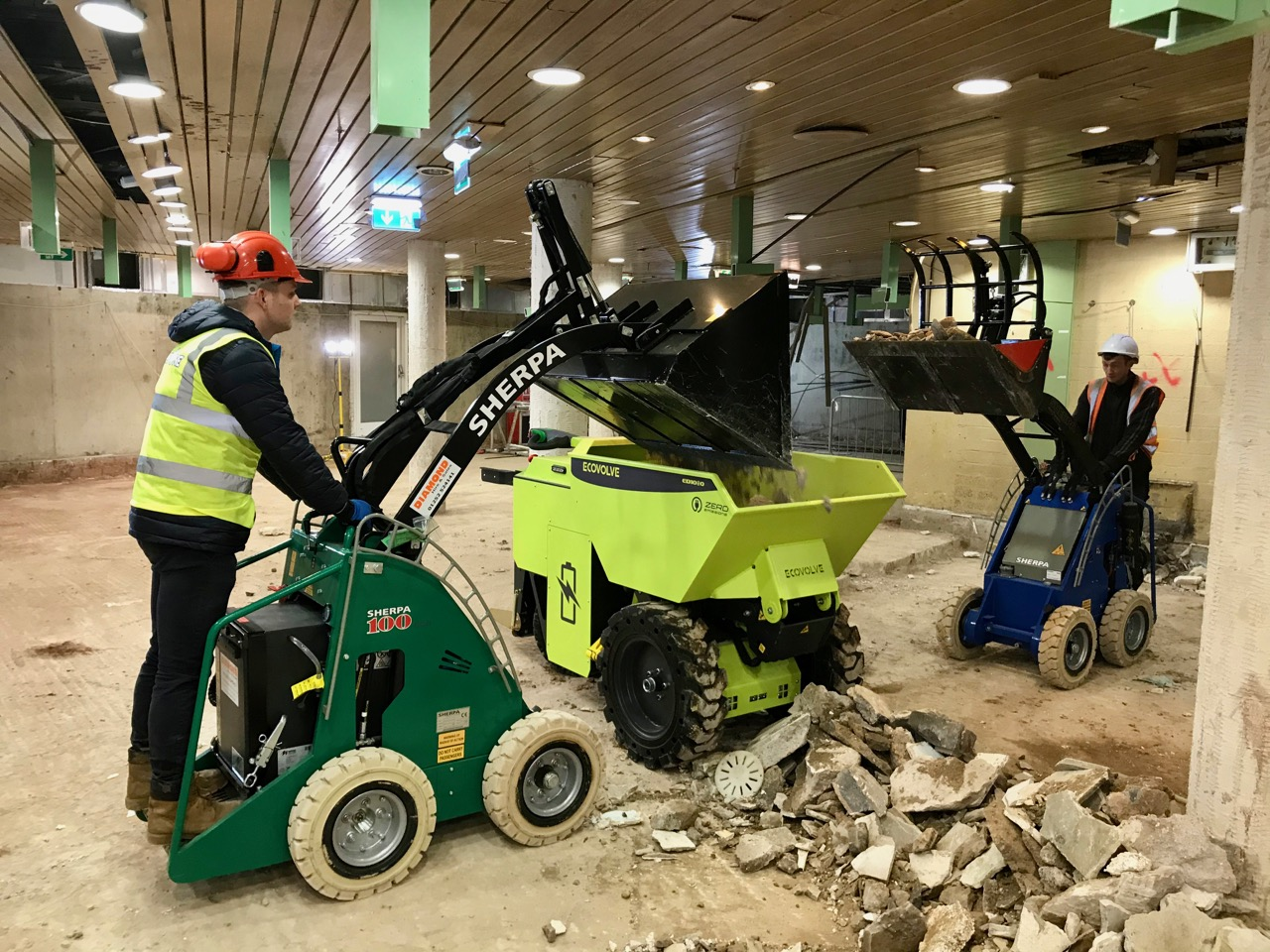 Loading an EcoVolve electric Dumper with the Sherpa Electric mini loader
