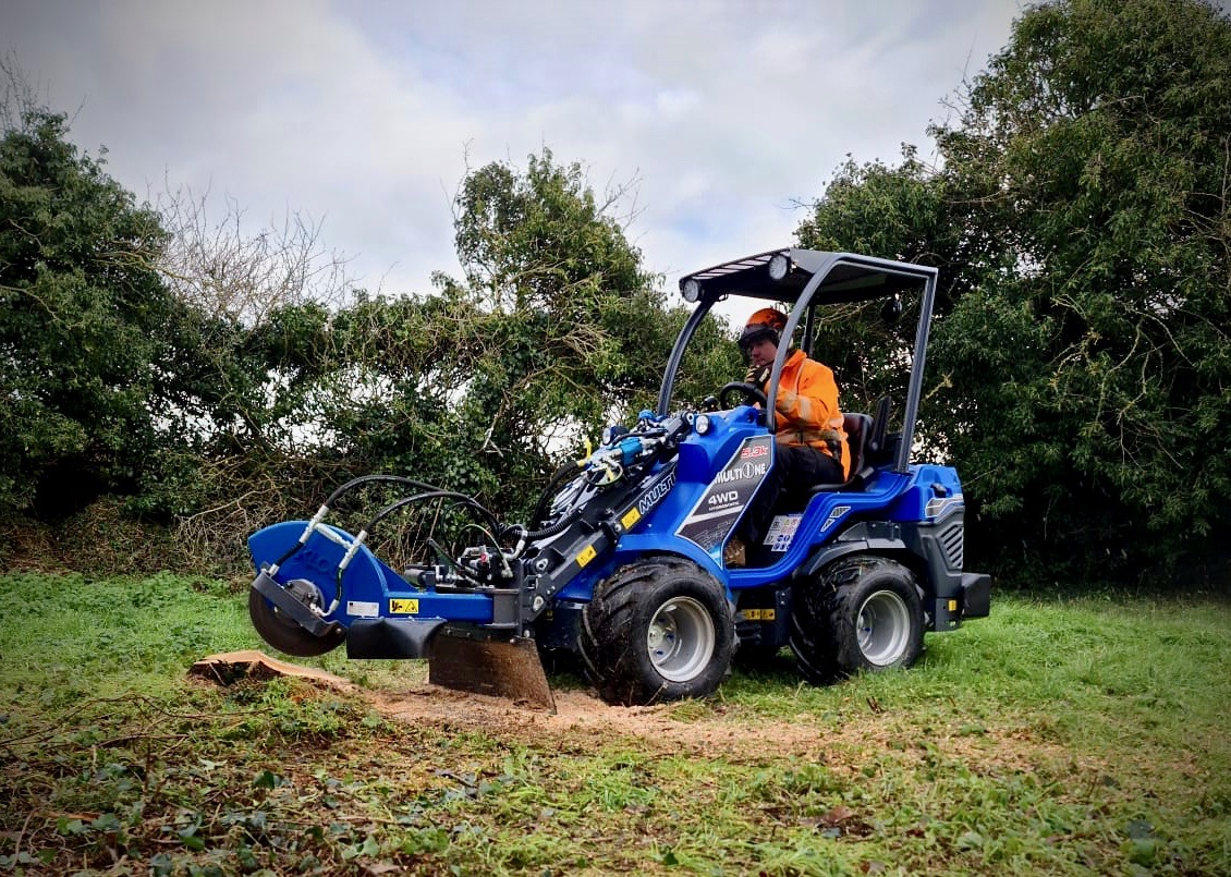 Powerful MultiOne 5.3K Utility loader with Stump Grinder Attachment